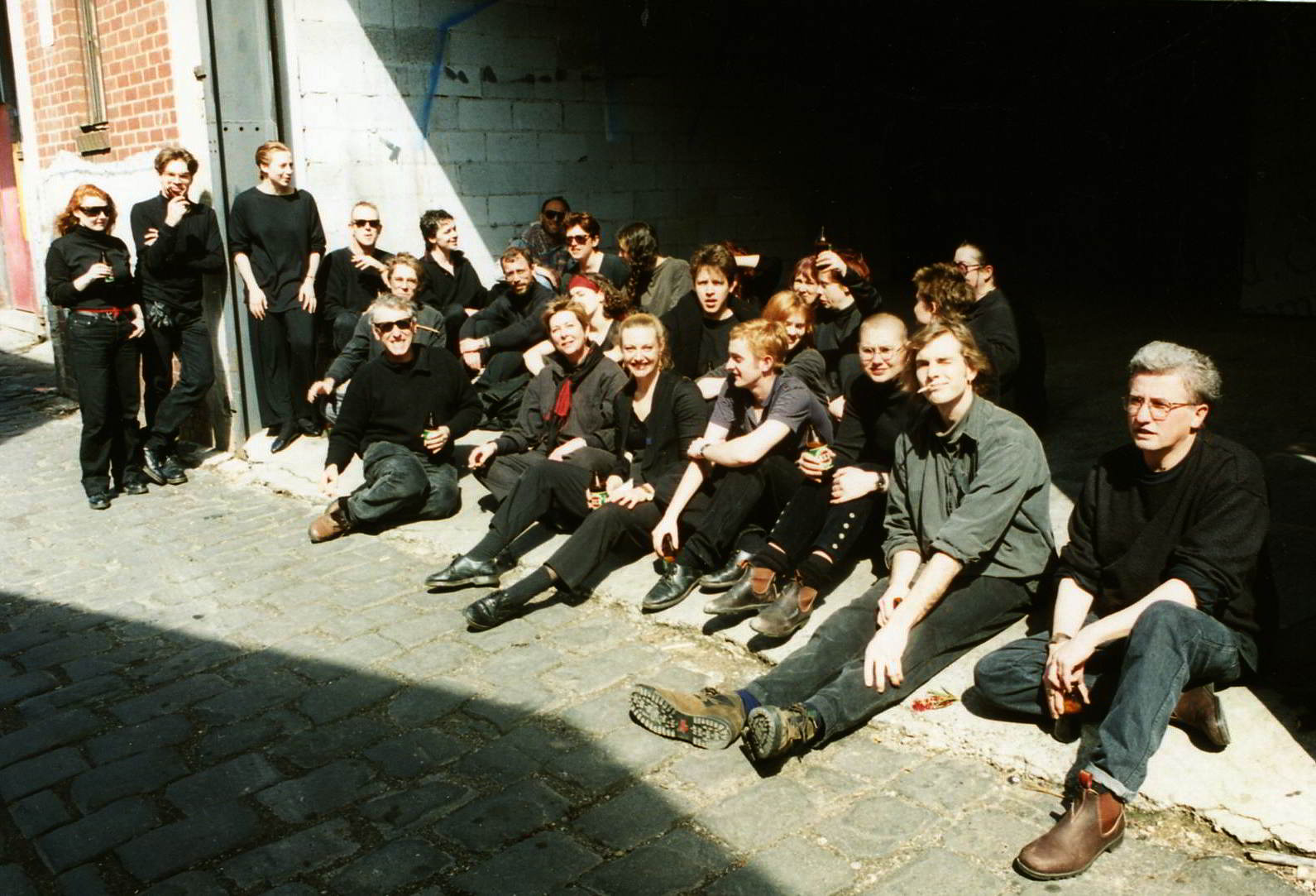 group portrait of performers resting after street show